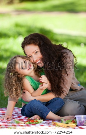 Mother and her daughter picnicking - stock photo