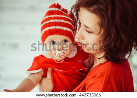 Mother and her daughter with a pacifier