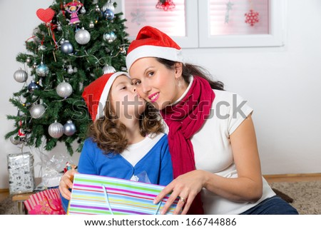 mother and her daughter with Christmas presents