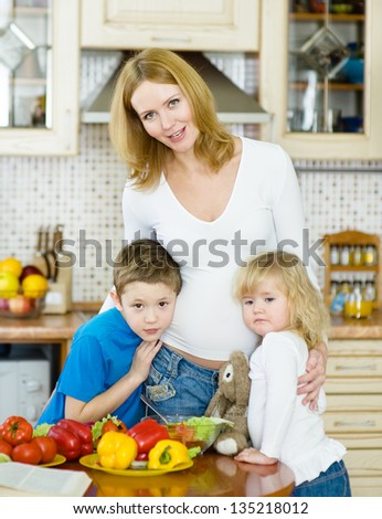 Mother and her kids in kitchen