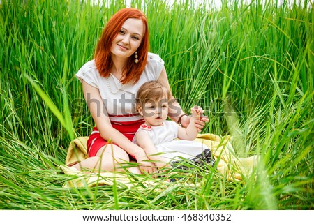 Mother and her little daughter at park