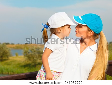 Mother and her little daughter at the golf course - stock photo