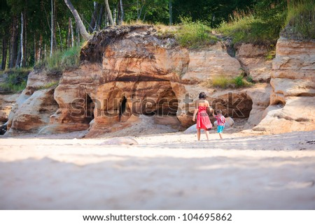 Mother and her little son playing outdoors - stock photo