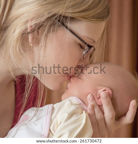 Mother and her Newborn Baby.  soft image of Beautiful Family. Maternity concept. Parenthood. Motherhood.