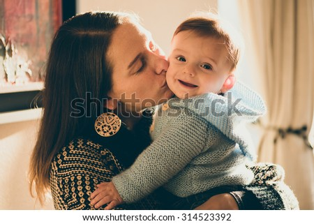 Mother and her son happy at home - stock photo