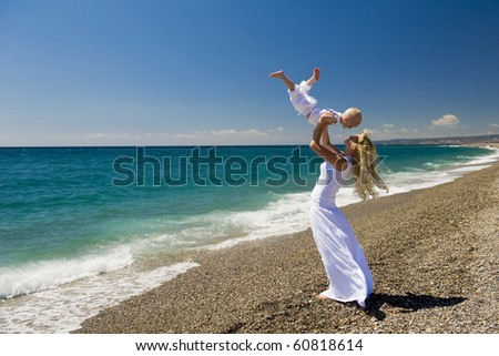 Mother and her son having fun on the beach.