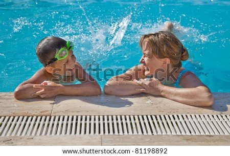 Mother and her son in the swimming pool - stock photo