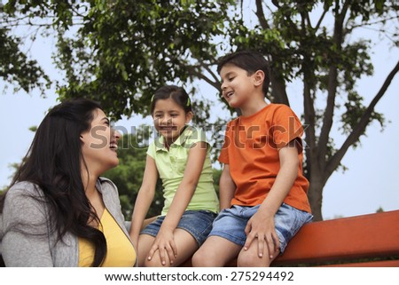 Mother and her two children enjoying outdoors - stock photo