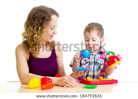 mother and kid boy playing together - stock photo