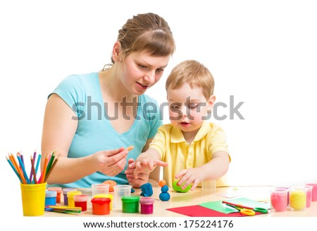 mother and kid plasticine modeling together isolated on white - stock photo