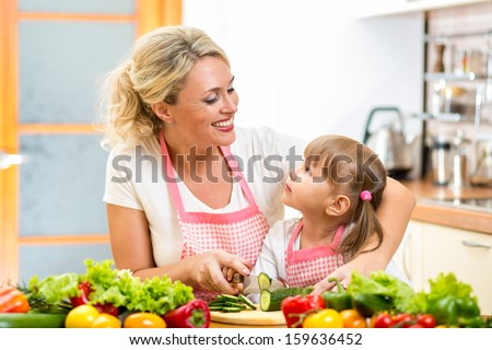 mother and kid preparing healthy food - stock photo