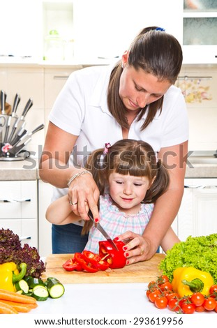 mother and kid preparing healthy food
