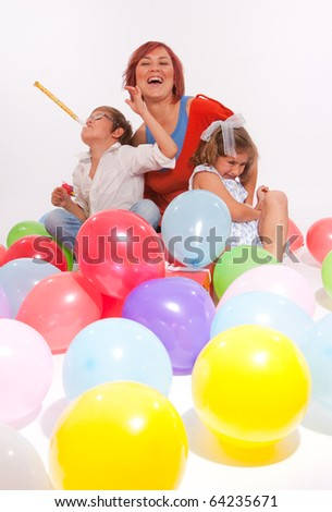 Mother and kids playing with colourful balloons