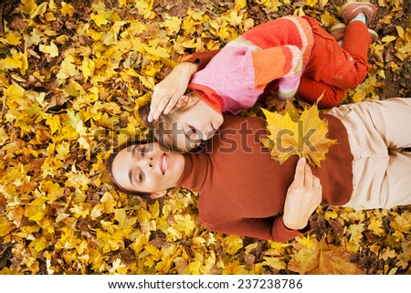 Mother and little daughter enjoying autumn day in a park - stock photo