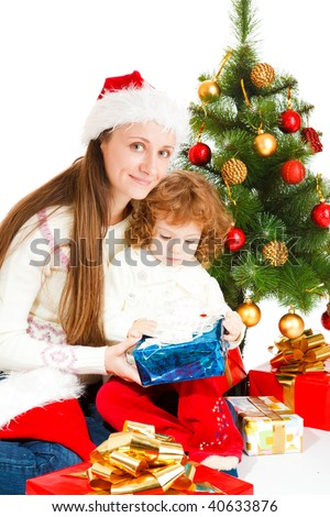 Mother and little daughter opening a present box