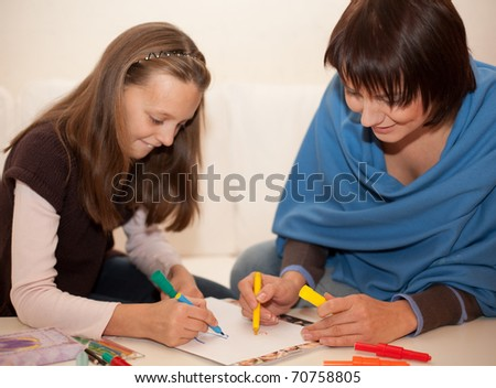 mother and little girl painting - stock photo