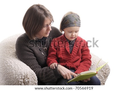 mother and little girl reading a story. isolated on white
