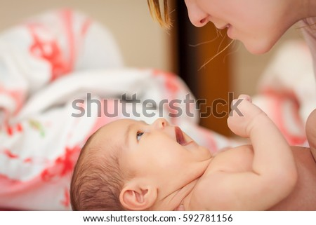 Mother and newborn laughing
