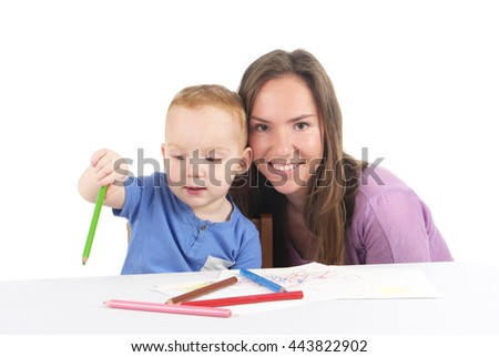 Mother and son are drawing the picture together - stock photo