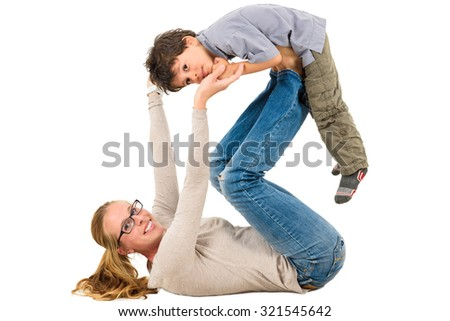Mother and son are exercising together. Active interracial family doing physical therapy exercises. - stock photo