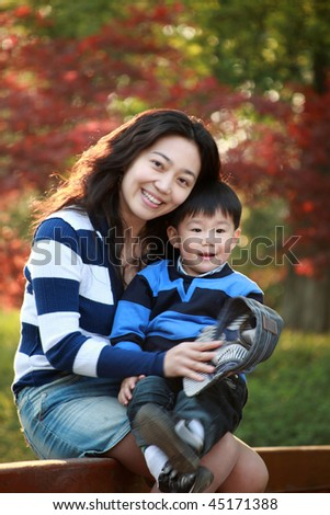 mother and son at garden - stock photo