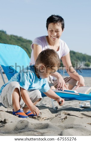Mother and son at the beach - stock photo