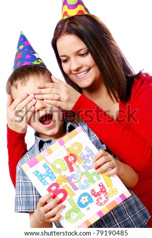 Mother and son celebrating his  birthday - stock photo