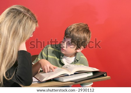 mother and son doing homework
