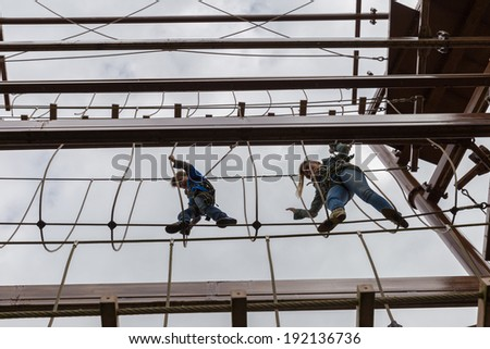 Mother and son engaging an obstacle course - stock photo