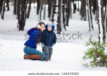 Mother and son enjoying beautiful winter day