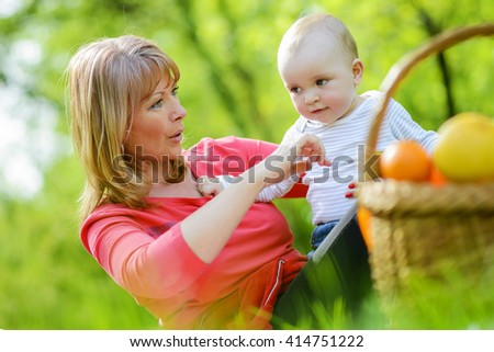 Mother and son enjoying outdoors - stock photo