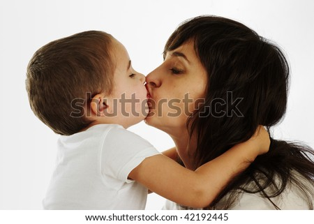 Mother and son gently kissing and hugging - stock photo