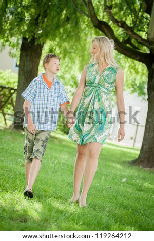 Mother and Son Hand in Hand - stock photo