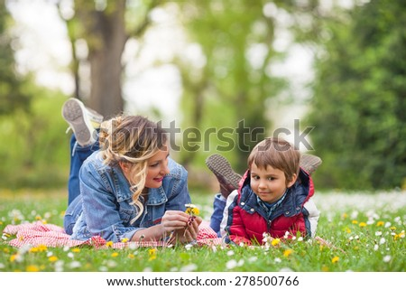 Mother and son having a picnic in the nature - stock photo