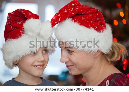 Mother and son having fun in christmas day - stock photo