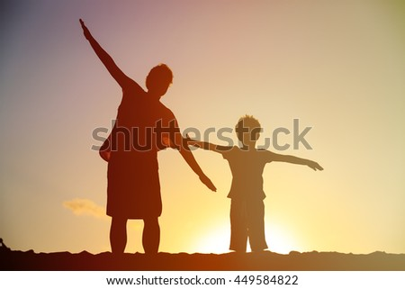 mother and son having fun on sunset
