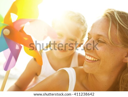 Mother and Son having fun on the beach. - stock photo