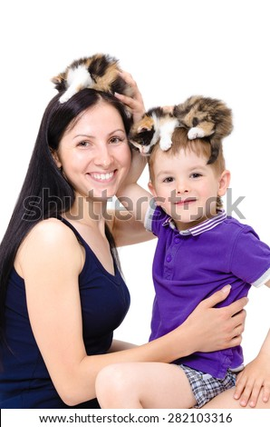 Mother and son having fun playing with kittens, closeup, isolated on a white background