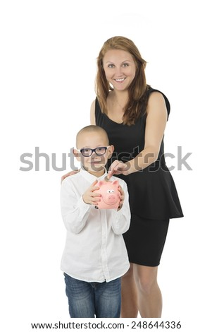 Mother and son holding a piggy bank against a white background - stock photo