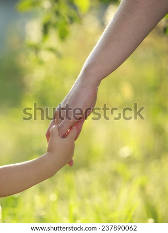 Mother and son holding hand in hand  - stock photo