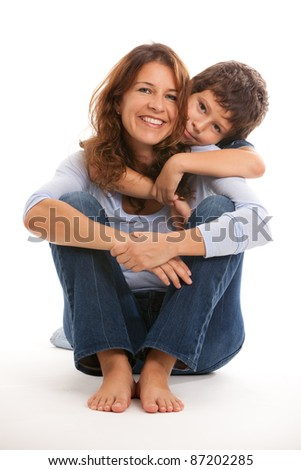 Mother and son in an affectionate pose on a white background.