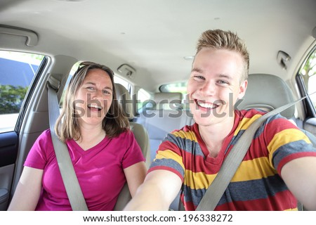Mother and son in car. Seat belt selfie - stock photo