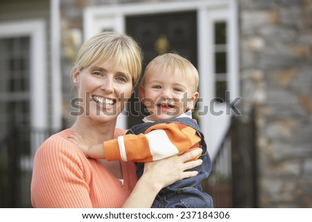 Mother and Son in Front of House - stock photo