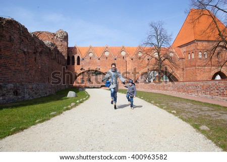 Mother and son in old town Torun. Poland - stock photo