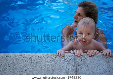 mother and son in swimming pool - stock photo