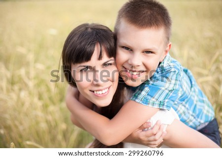 Mother and Son in the field - stock photo