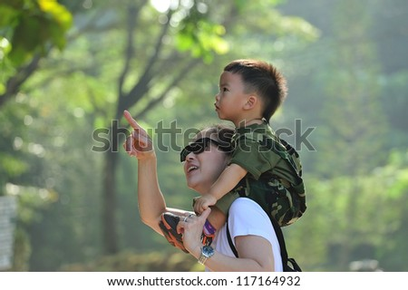 Mother and son in the park - stock photo