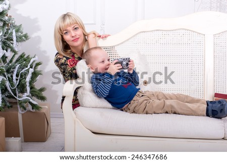 Mother and son laughing while sitting on the couch