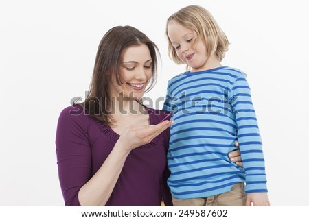 Mother and son looking at greeting card, smiling