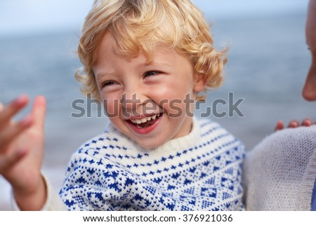 Mother And Son On Beach Together - stock photo